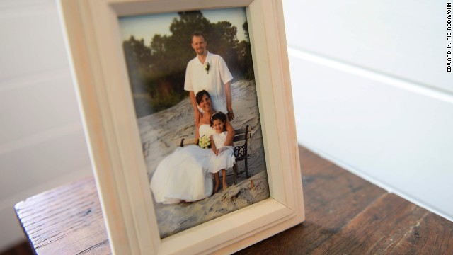 "A 2006 portrait of the Kolbeck family on Dane and Suzannah's wedding day sits inside Sicily's tiny house. In a post on her tiny house blog, <a href='http://tinymaison.blogspot.com/' target='_blank'>La Petite Maison</a>, Sicily wrote, ""If you have a blank wall, you don't need fill it up with meaningless pictures. Tell a story with your space."""