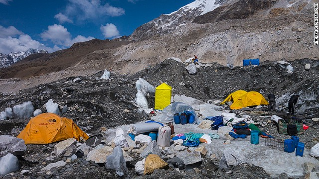 The camps of different expeditions being dismantled. Base Camp is usually a vibrant village. People play golf on the ice, hike along the icefall river, make new friendships, play cards during the day, and attend parties at night.