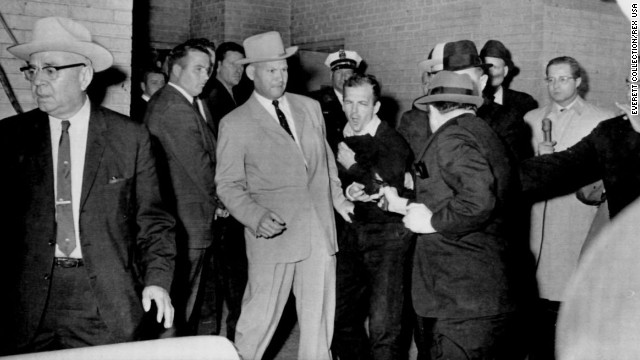 Two days after Kennedy's assassination, Lee Harvey Oswald -- the man who had been charged with killing the president -- was fatally shot by Jack Ruby as Oswald was being escorted through the Dallas police basement. Oswald's shooting was shown live on national television.