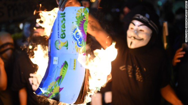 Protesters in Brazil have taken to burning sticker albums to show their frustration at FIFA and the country's government in hosting the World Cup.