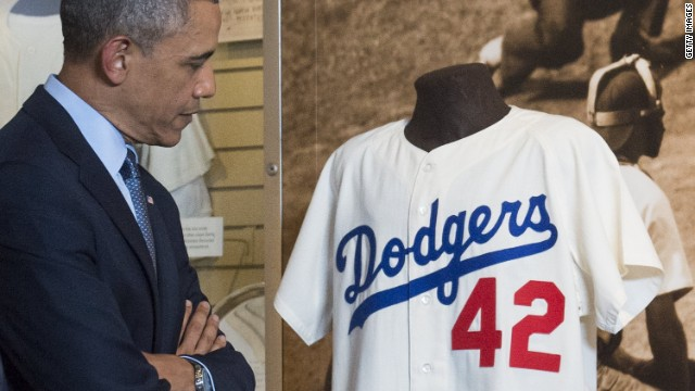 At baseball Hall, Obama holds 'Joltin Joe's' glove, talks tourism