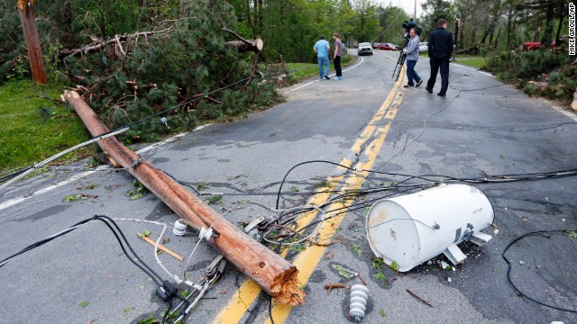 A downed utility pole blocks a road in Duanesburg, New York, on May 22.