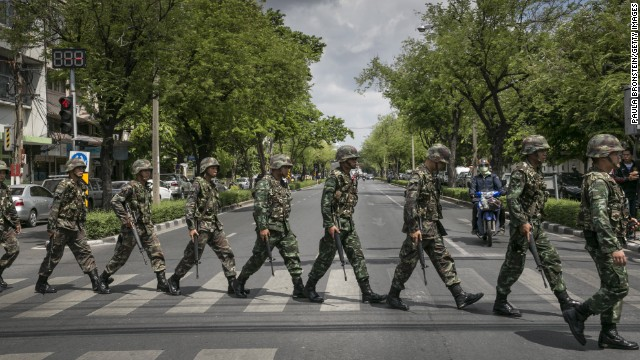 Thai soldiers patrol near government buildings in Bangkok on Friday, May 23. Thailand's army announced the previous day that it has taken control of the country in a coup, just days after it surprised the government by declaring martial law. <a href='http://www.cnn.com/2014/05/19/asia/gallery/thailand-crisis/index.html' target='_blank'>See the Thai army impose martial law before the coup.</a>