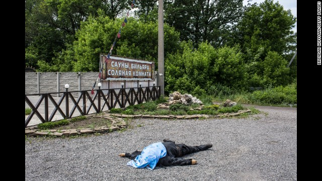 The body of a pro-Ukrainian militia fighter lies along a road in Karlivka on May 23.