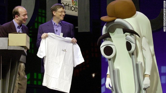 "Microsoft CEO Bill Gates presents a T-shirt as a retirement gift to ""Clippy"" -- or someone dressed as the virtual Microsoft Office assistant -- a cartoon paper clip that once popped up on screens to assist and annoy users of the workplace software. Clippy was widely mocked before Microsoft retired the character in 2001."