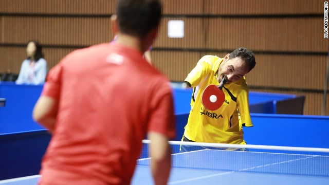 Hamadto started playing table tennis at 13, three years after losing both his arms in a train accident.