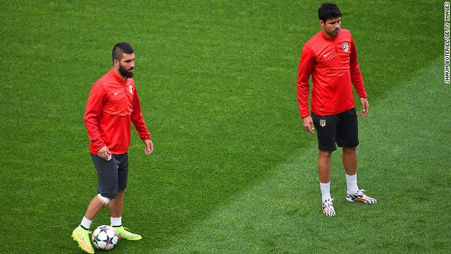 Arda Turan anad Diego Costa train with teammates ahead of the 2014 Champions League final in Lisbon.