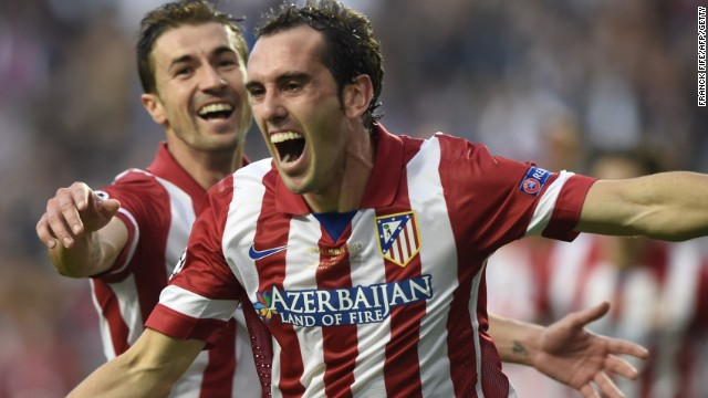 Atletico's Diego Godin puts his side 1-0 up over Real Madrid during their match in Lisbon.
