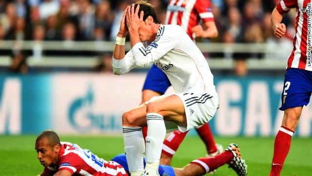 Bale holds his head in his hands in disbelief after wasting Real's best chance of the first half against Atletico.