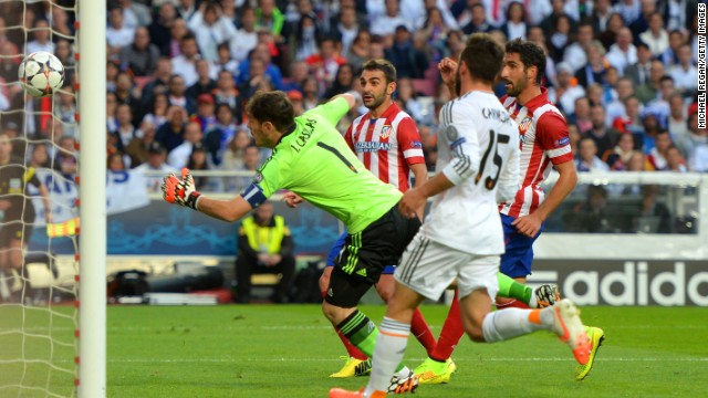 Casillas makes a desperate attempt to keep out Godin's header as his side fell behind in the Champions League final.
