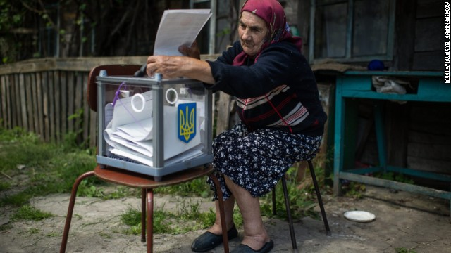 An elderly woman casts her vote May 25 as a mobile Ukrainian election committee visited Orane, a village north of Kiev.