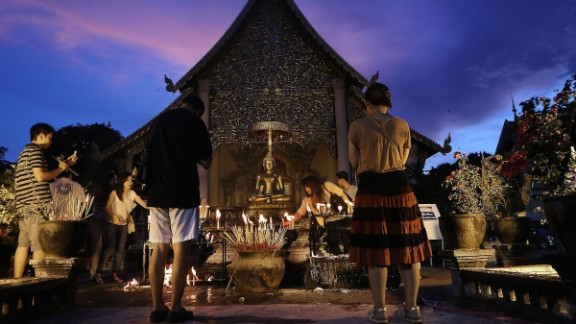 Thai Buddhists make offerings at Chiang Mai's Wat Chedi Luang, located in the historic center of the city.