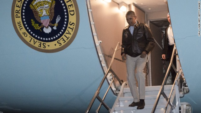Obama disembarks from Air Force One as he arrives at Bagram Airfield.