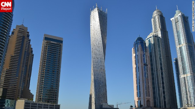 "The 80-story <a href='http://ireport.cnn.com/docs/DOC-1129094'>Cayan Tower</a> is a residential building in Dubai, United Arab Emirates. ""Its unique helix-shaped design is futuristic because it redefines what one might think of as the 'normal' architectural characteristics of a skyscraper,"" said iReporter Lynda Martinez."