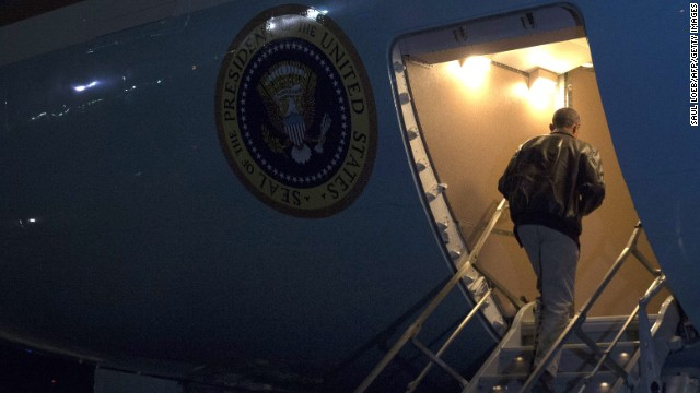 President Barack Obama boards Air Force One before departing Bagram Air Field. Obama landed Sunday, May 25, in Afghanistan for an unannounced trip to visit with U.S. forces on Memorial Day weekend. He thanked the troops for their service as the United States hands over responsibility to Afghan forces.