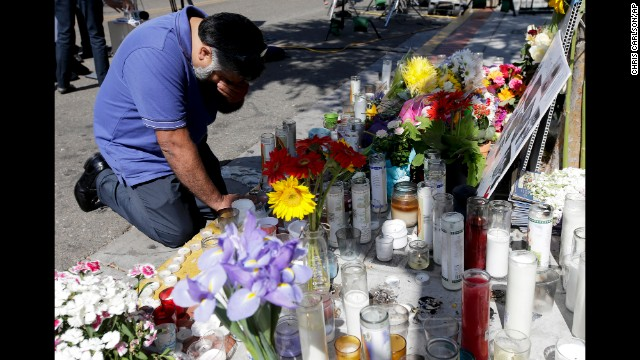 Jose Cardoso pays his respects Sunday, May 25, at a makeshift memorial at the IV Deli Mart, where part of a mass shooting took place, in Isla Vista, California. Elliot Rodger, 22, went on a rampage Friday night, May 23, near the University of California, Santa Barbara, stabbing three people to death at his apartment before shooting and killing three more in a nearby neighborhood, sheriff's officials said. Rodger also injured 13 others and died of an apparent self-inflicted gunshot wound, authorities said.