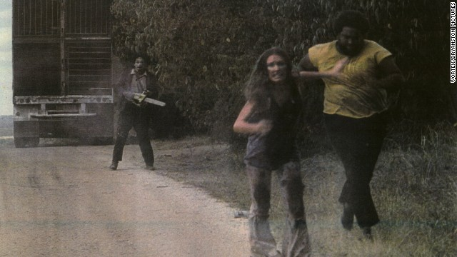 Marilyn Burns (center) runs from