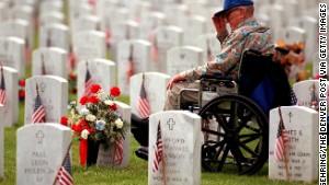 Air Force veteran Joseph Parnell Sr., visits the grave of his son, Joseph Parnell Jr., at Fort Logan National Cemetery.