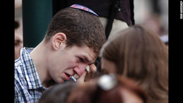 A man wipes away tears during a vigil in front of the museum on May 25.
