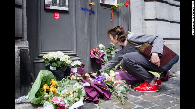 A woman lays flowers at the museum entrance on May 25.