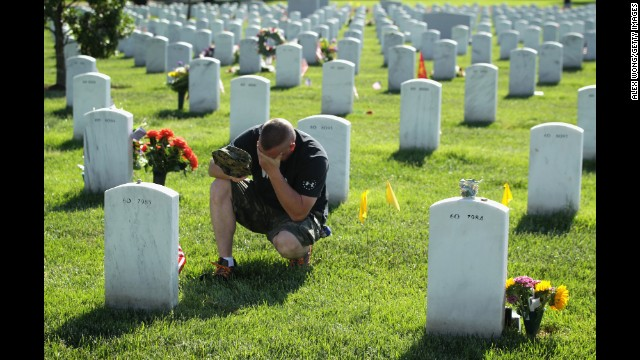 Mike Sunderhaus of Bel Air, Maryland, becomes emotional Sunday, May 25, as he visits the grave of his friend, Marine Lance Cpl. Jeremiah E. Savage, at Arlington National Cemetery. Savage was killed in 2004 during Operation Iraqi Freedom.