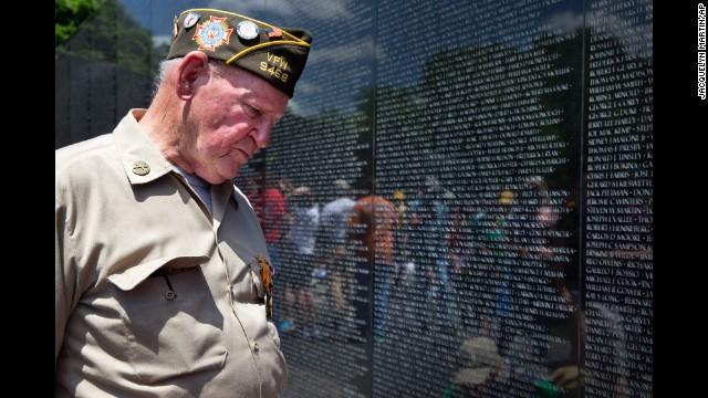 World War II veteran Jimmy Bishop Jr. looks at names on the Vietnam Veterans Memorial in Washington on May 25.