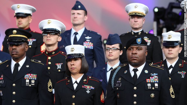 Military personnel stand at attention May 25 during the National Memorial Day Concert at the Capitol in Washington.