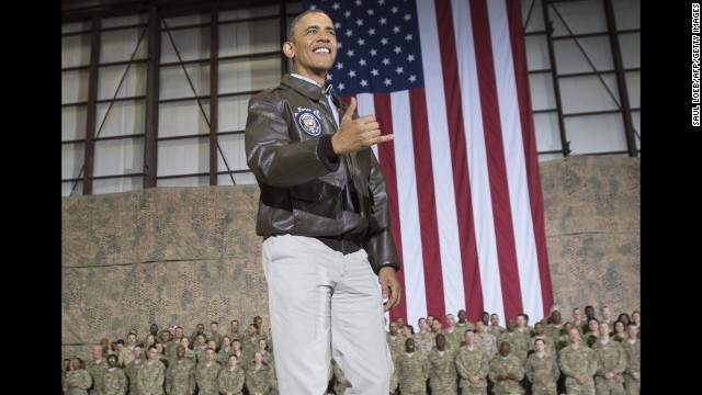 "Obama does a Hawaiian ""shaka"" as he greets U.S. troops during a surprise visit to Afghanistan on May 25."
