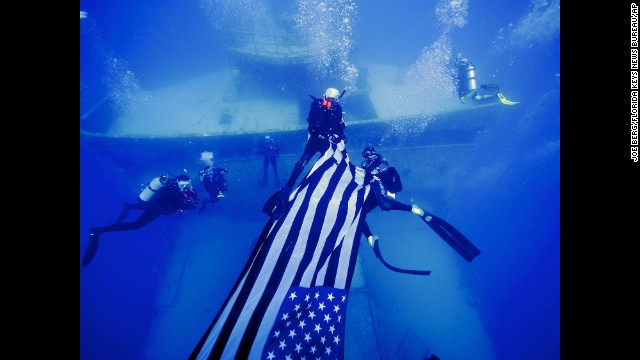 Divers deploy an American flag on the USNS General Hoyt S. Vandenberg, an artificial reef about seven miles off Key West, Florida, on May 25.