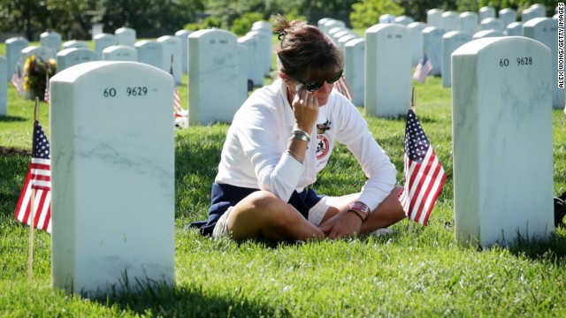 Sarah Greene wipes tears as she visits the grave of her husband, Marine Lt. Col. David S. Greene, at Arlington National Cemetery on May 25. He was killed in Iraq in 2004.