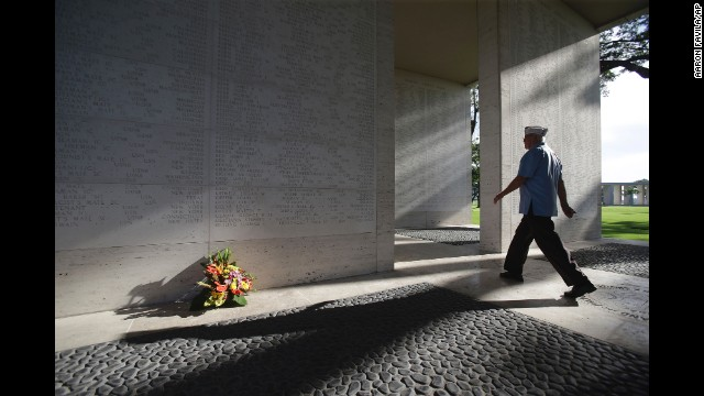An American veteran passes by marble walls engraved with names of fallen U.S. soldiers at the Manila American Cemetery and Memorial in Taguig, Philippines, on May 25.
