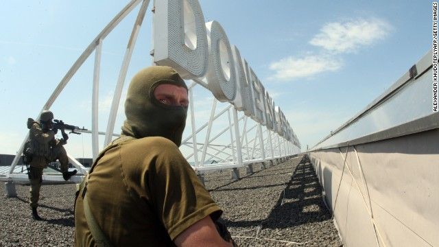 Pro-Russian militants take position on the roof of Donetsk International Airport on Monday, May 26.