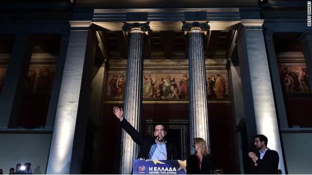 Syriza's leader Alexis Tsipras waves at his supporters after the results of the European elections, outside the Athens University, on May 25, 2014.