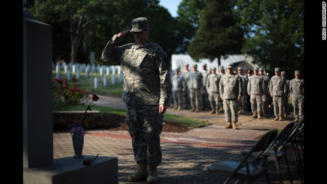 Pvt. John Schena of the Georgia State Defense Force salutes after placing a rose at a Pearl Harbor memorial May 26 at Marietta National Cemetery in Marietta, Georgia.