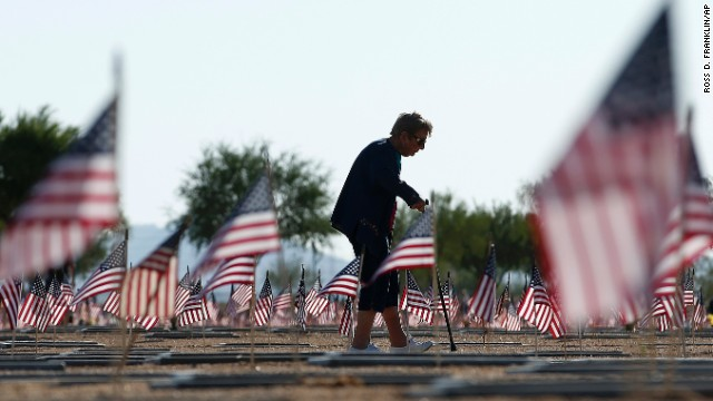 After visiting the grave of her husband, World War II veteran William Murphy, Raymonde Murphy walks past graves at the National Memorial Cemetery of Arizona in Phoenix on May 26.