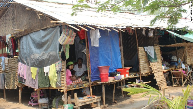 Many people displaced by last year's rioting remain in poor quality, makeshift shelters.