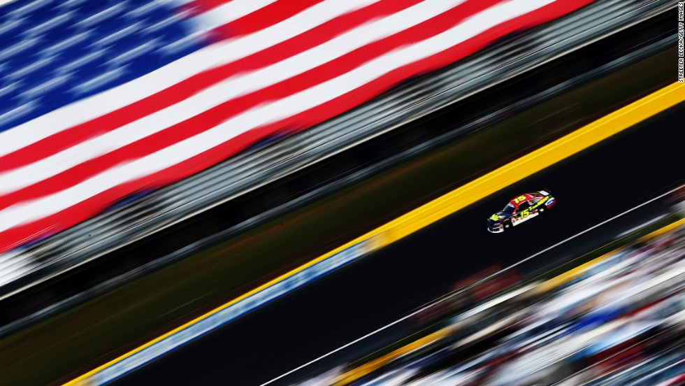 Using a panning motion and a slow shutter speed, a photographer captured this shot of NASCAR driver Clint Bowyer during the Coca-Cola 600 on Sunday, May 25, at Charlotte Motor Speedway in Concord, North Carolina. Jimmie Johnson won the race, which traditionally takes place on Memorial Day weekend.