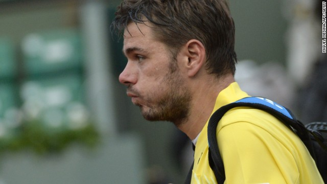 A disconsolate Stanislas Wawrinka makes his exit from Philippe Chatrier after a first round French Open defeat.