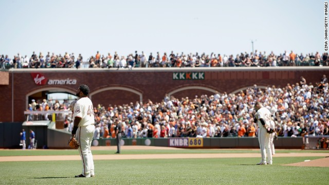Pablo Sandoval, left, and David Huff of the San Francisco Giants stand for a moment of silence during their Memorial Day game against the Chicago Cubs at AT&T Park in San Francisco on May 26.