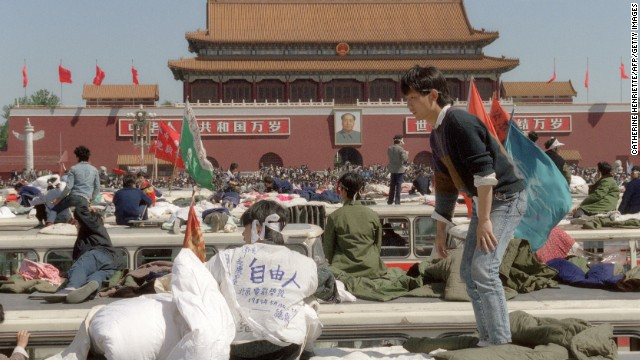 Student hunger strikers camp out on top of buses parked at Tiananmen Square.