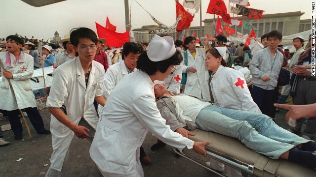 May 17, 1989: Five days in and the hunger strike begins to take its toll on students. Paramedics evacuate ailing protestors from the square.