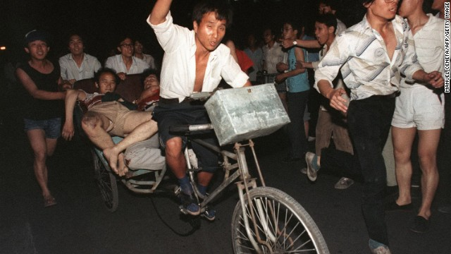 On the night of June 3 and into the early hours of June 4, armed troops and tanks moved in on students and other civilians in the areas around Tiananmen Square, opening fire on the crowds.