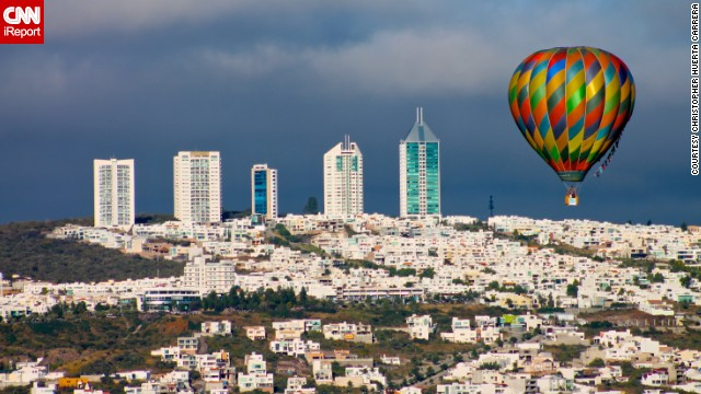 A colorful hot air balloon floats over the city of <a href='http://ireport.cnn.com/docs/DOC-1081746'>Leon</a> in the Mexican state of Guanajuato during 2013's International Balloon Festival. Since the festival began in 2002, it has become a large international event.