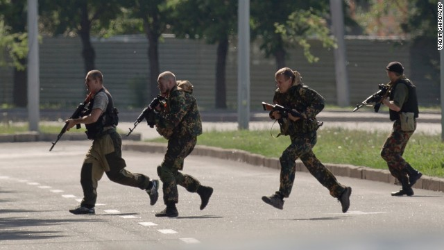 Pro-Russian gunmen take positions near the airport on May 26.