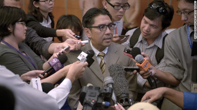 Members of the media scramble to speak with Azharuddin Abdul Rahman, director general of Malaysia's Civil Aviation Department, at a hotel in Kuala Lumpur, Malaysia, on Tuesday, May 27. Data from communications between satellites and missing Malaysia Airlines Flight 370 was released Tuesday, more than two months after relatives of passengers say they requested that it be made public. The flight has been missing since March 8.