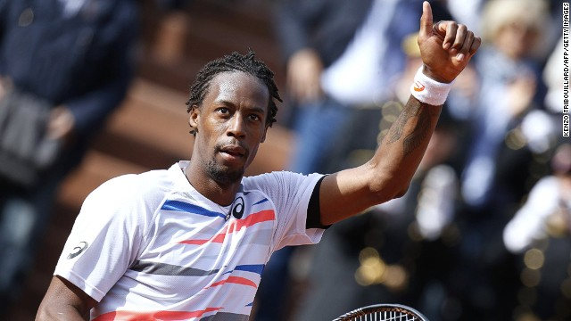 Home favorite Gael Monfils celebrates after winning his first round match against Romania's Victor Hanescu.