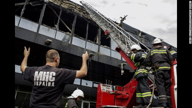 Firefighters work on extinguishing a fire at a local sports hall in Donetsk on May 27.