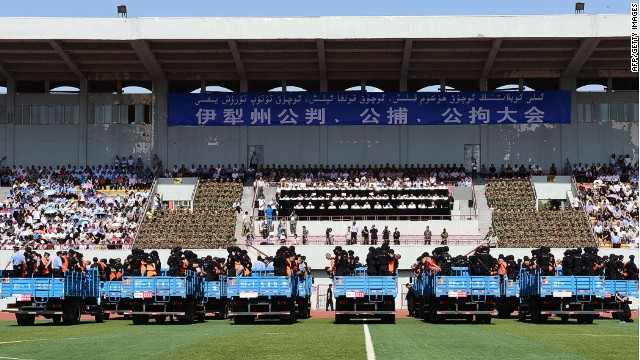 Dozens of terror suspects are found guilty before 7000 spectators at a stadium in China's Xinjiang Province.