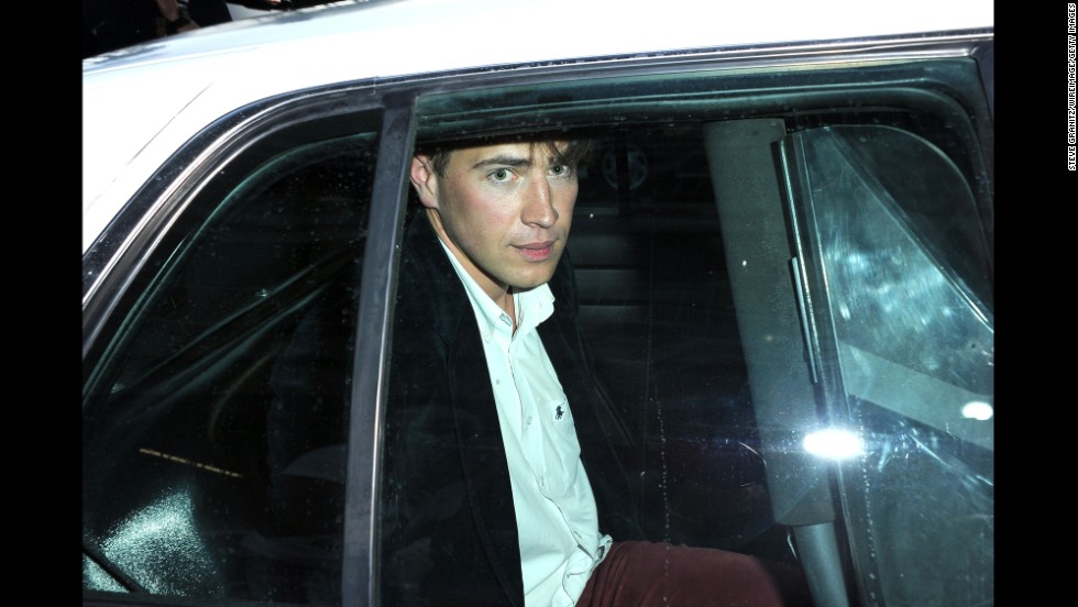 "Vitalii Sediuk sits in the back of a police car after allegedly striking Brad Pitt in the face as Pitt and Angelina Jolie walked the red carpet at the premiere of Disney's ""Maleficent"" in Hollywood, California, on Wednesday, May 28. Sediuk has a history of confronting celebrities at red carpet events."