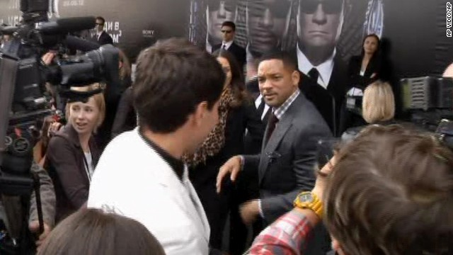 "Will Smith walks away after slapping Sediuk, white jacket, who had just tried to kiss him, on the red carpet of the premiere of ""Men in Black III"" in Moscow in 2012."